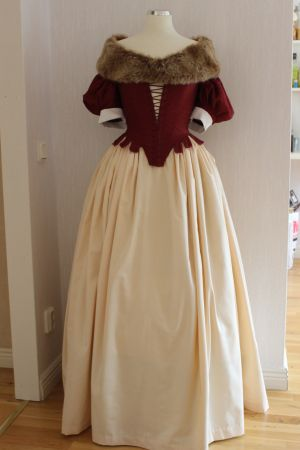 17th century bodice, skirt, coif and fur over quilted petticoat, accessoriced with a string of pearls