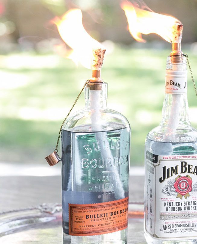 Light up your outdoor cocktail party with these liquor bottle tiki torches.