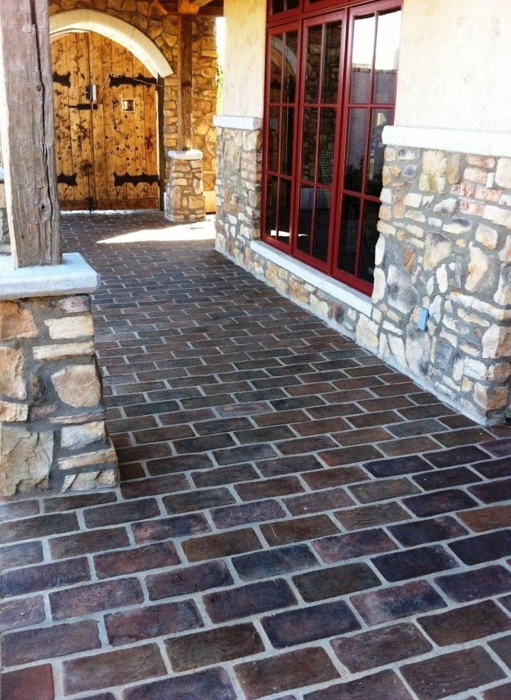 This Beautiful Spanish Style Outdoor Walkway Is Laid In 6x12 Manganese  Saltillo Tile.