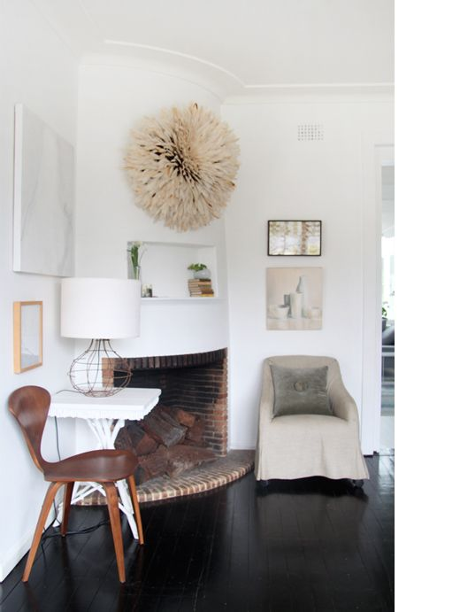 Inside Megan Morton's home...love the feathered wall hanging (think it's a head dress of some sort?)...textural focal point. Pic from The Design Files