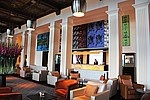 Andy Warhol's Big Retrospective Painting, spanning 10 metres, holds pride of place above the front desk
