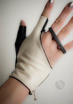 The Revolver glove by Mila Hermanovski, allows you to wear a ring while wearing a glove. Fun!