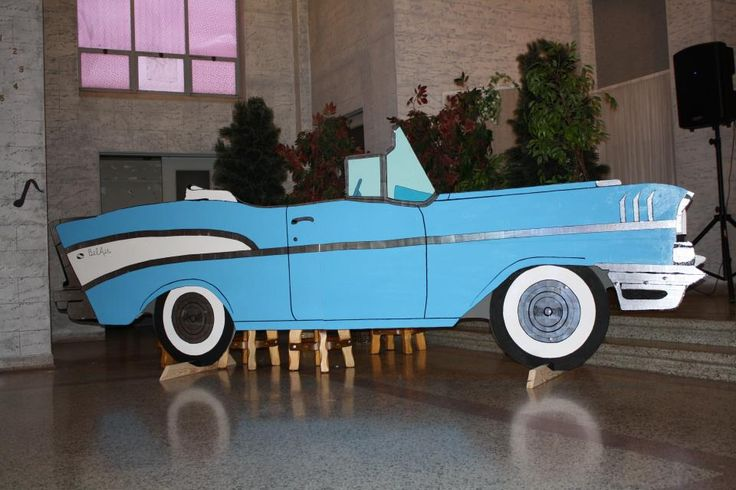 1957 Chevy Bel Air Convertible made out of fiberboard, 2x4s for supports, 2x2s in the back, paint and time. I made it for a Home School Spring Fling (like a formal prom) so they could take their pictures next to it. The theme for the night was 50's so everyone was dressed in formal 50s attire. The car had to be shortened to get it to the second floor of the building!