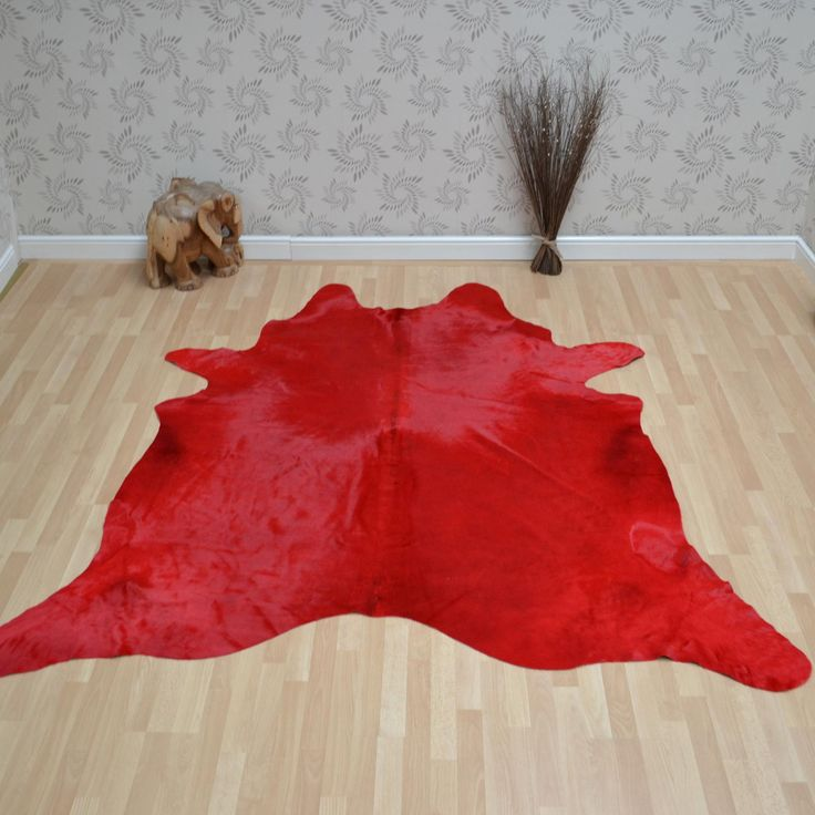 """Cowhide rug in red - extra large 238x232cm (7'10""""x7'7"""") : £359.00 http://www.therugseller.co.uk/cowhide-rug-in-red-extra-large/p-29-45-15224-0 . This stunning cowhide looks absolutely amazing in Red."""