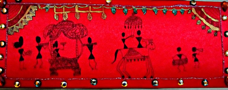This is a wedding card which is painted with warli design, rhinestones are added for glittering effects and pearl colour for glowing touch