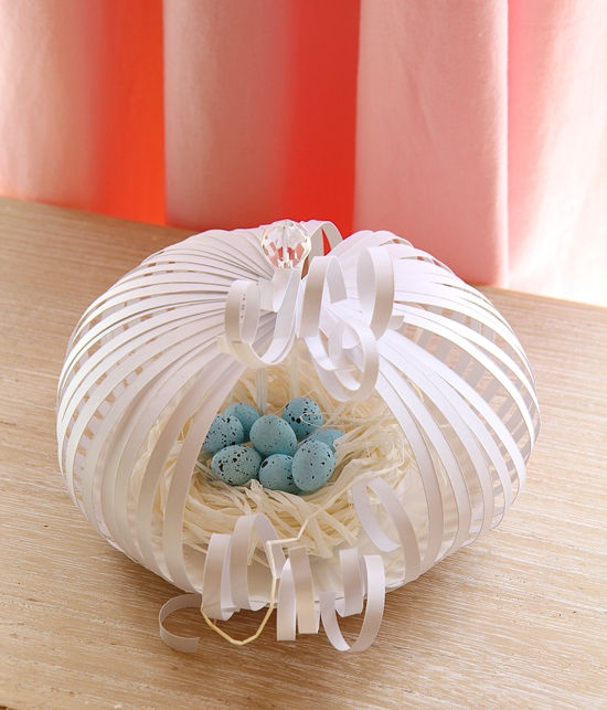 Little cages, made from paper plate and scrap paper strips - to hold your Easter eggs
