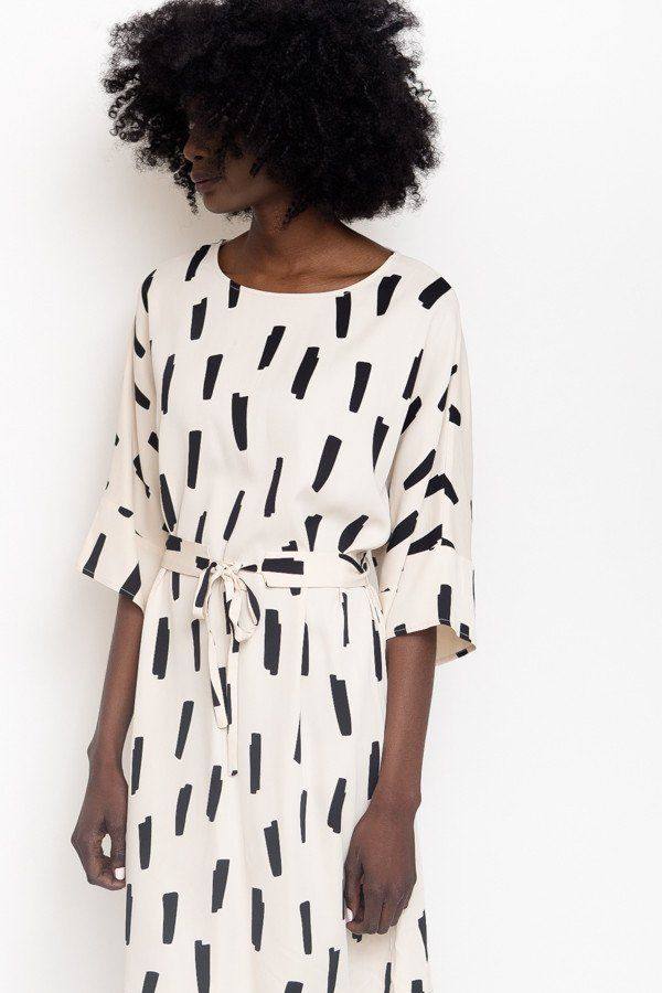 "STYLE | Just Female Agnete Dress is an effortless dress featuring 3/4 wide sleeves, attached belt, boat neck in an ivory and black brush stroke print. Model is 5'9"" and wears size x-small. - Fits true to size"
