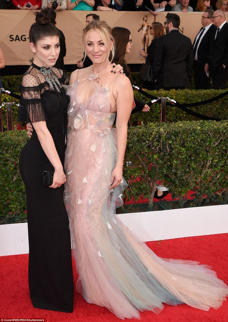 All in the family: Kaley's sister Briana Cuoco (left) didn't fare much better in her extremely gothic look