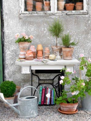 Old sewing machine cabinet used in garden