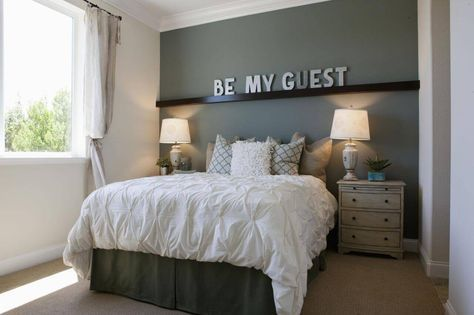 An instant way to add a personal touch to any small guest room is to install a long wall shelf that spans the length of the wall, like seen above, adorned with decorative letters that spell out a special phrase and compliment an bold, accent wall color behind.