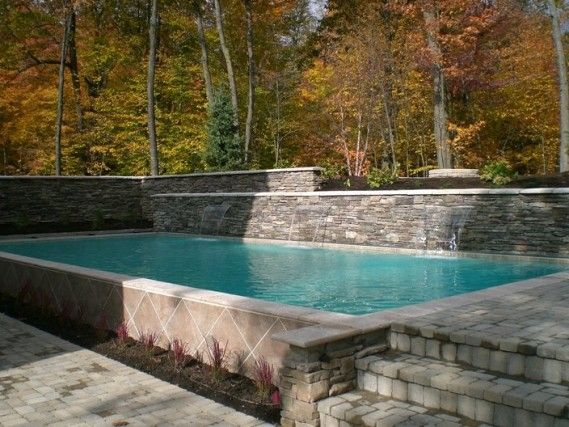 17 best images about retaining walls by signature on for Raised pool designs