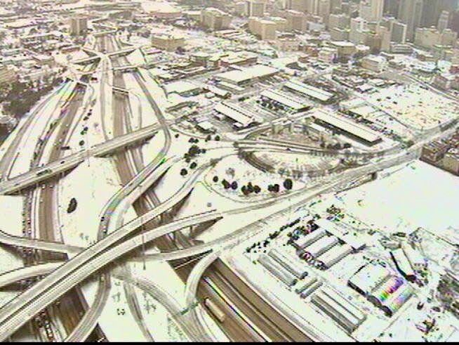 Dallas, Texas, Dec. 29, 1978-Jan. 4, 1979: It was considered the worst ice storm in Texas in 30 years. Thunderstorms rolled in and dumped freezing rain onto a giant swath of very cold Texas, and immediately the power lines began to give. People went without power for days, some up to a week. I believe the highway in the photo is I-30.