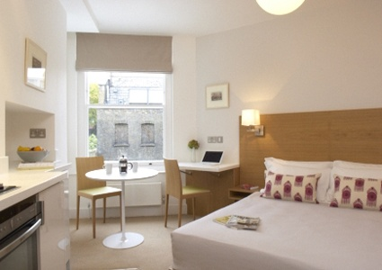 #Bloomsbury, #London #Vacation #Rentals- Lovely Double #Studio opposite #Charles #Dickens #Museum - The 'open-plan' double apartments are bright and airy with large windows and simple lines, creating a sense of understated style. The beds are flanked by specially designed bedside tables and lamps that have been crafted to create a relaxing ambience.  http://holidayporch.com/rental-218