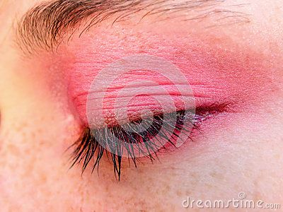 A close-up view of a teenage age girls closed eye with soft pink, spring eye shadow.