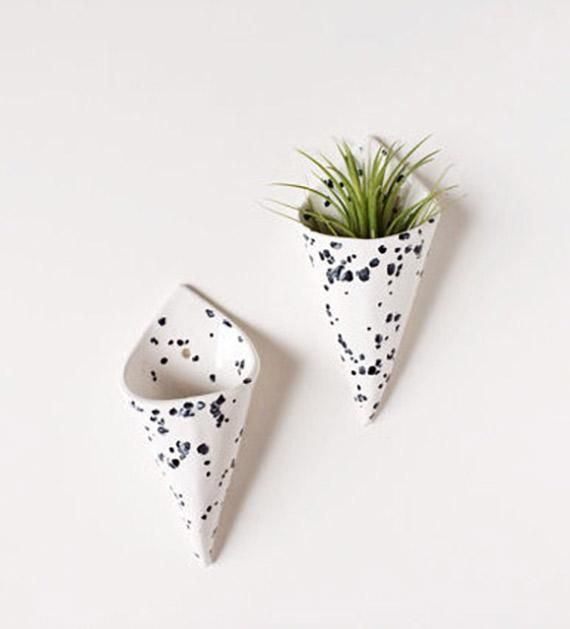 Speckled ceramic cone-shaped planters are like vases for your wall.