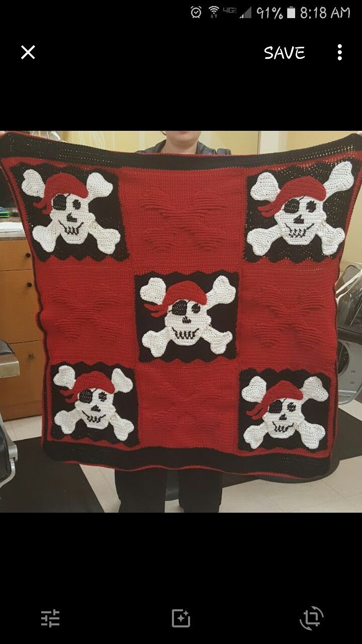 """This was made for my loving wanna be pirate husband Grey Beard for his birthday. Used a pattern I found on here. It is a free pattern goggle 'Coolest pirate blanket ever""""."""