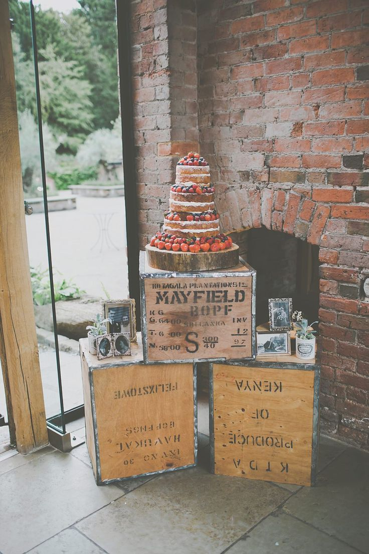 Naked Caked Decorated with Berries stop on Rustic Wooden Crates | DIY Rustic Wedding at Shustoke Farm Barns in Warwickshire | Images by James Melia | http://www.rockmywedding.co.uk/jo-lee/