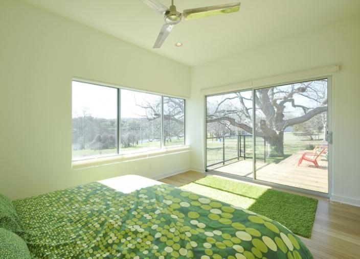Custom prefab modular house with patinated metal facade, Austin, Texas: Modern prefab homes. Modular homes. Manufactured homes