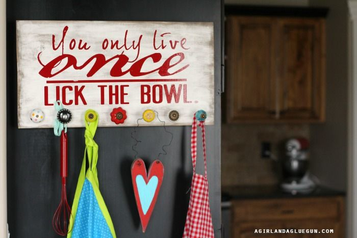 kitchen apron rack with hobby lobby knobs (really pinned it for the sign)