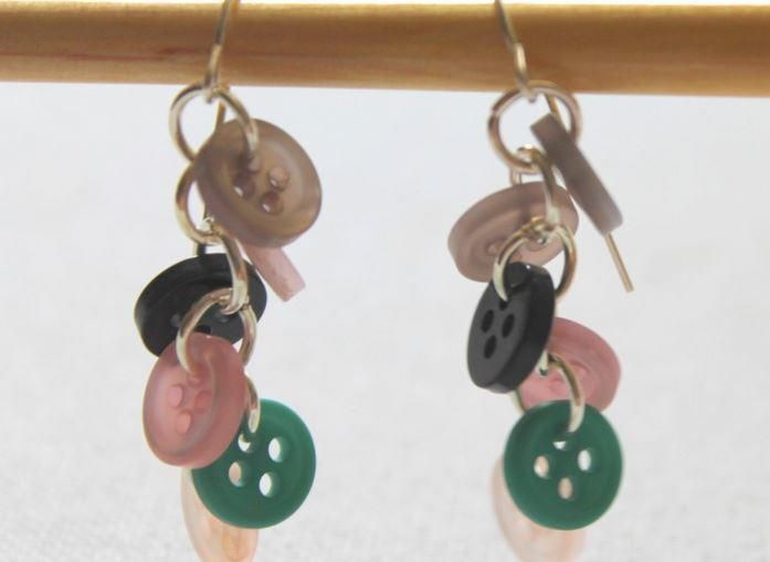 These Utterly Adorable Button DIY Earrings are adorable and super quick to make. All you need are some earring hooks, jump rings, and (of course) the buttons you want hanging from your ears. Check out this video tutorial to make your own!
