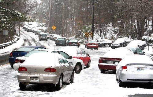 A row of abandoned vehicles litters the access road off the Pleasantdale Road exit at I-85 northbound in Norcross Tuesday, Jan. 11, 2011