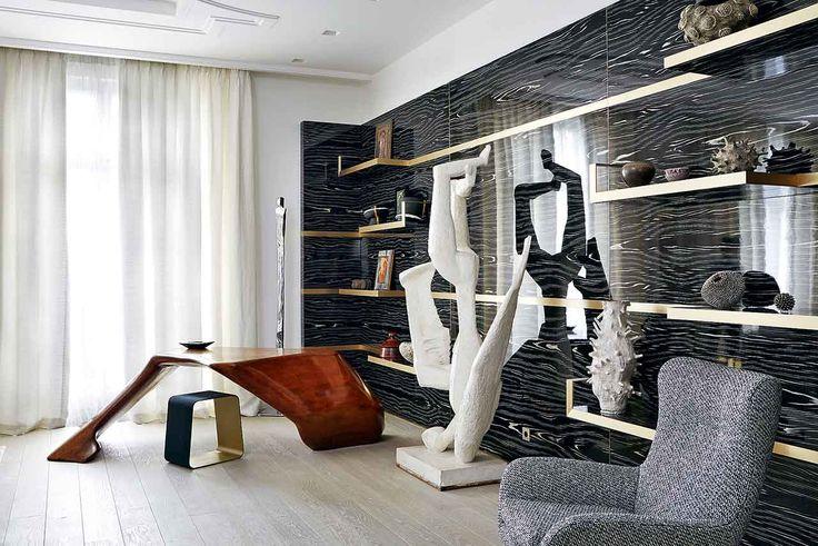 Дизайн панелей New Ebony иполок сотделкой избронзы С.Кутас придумала сама. Фигуре Икара скульптора  Андре Виллека аккомпанируют формы винтажного стола издуба
