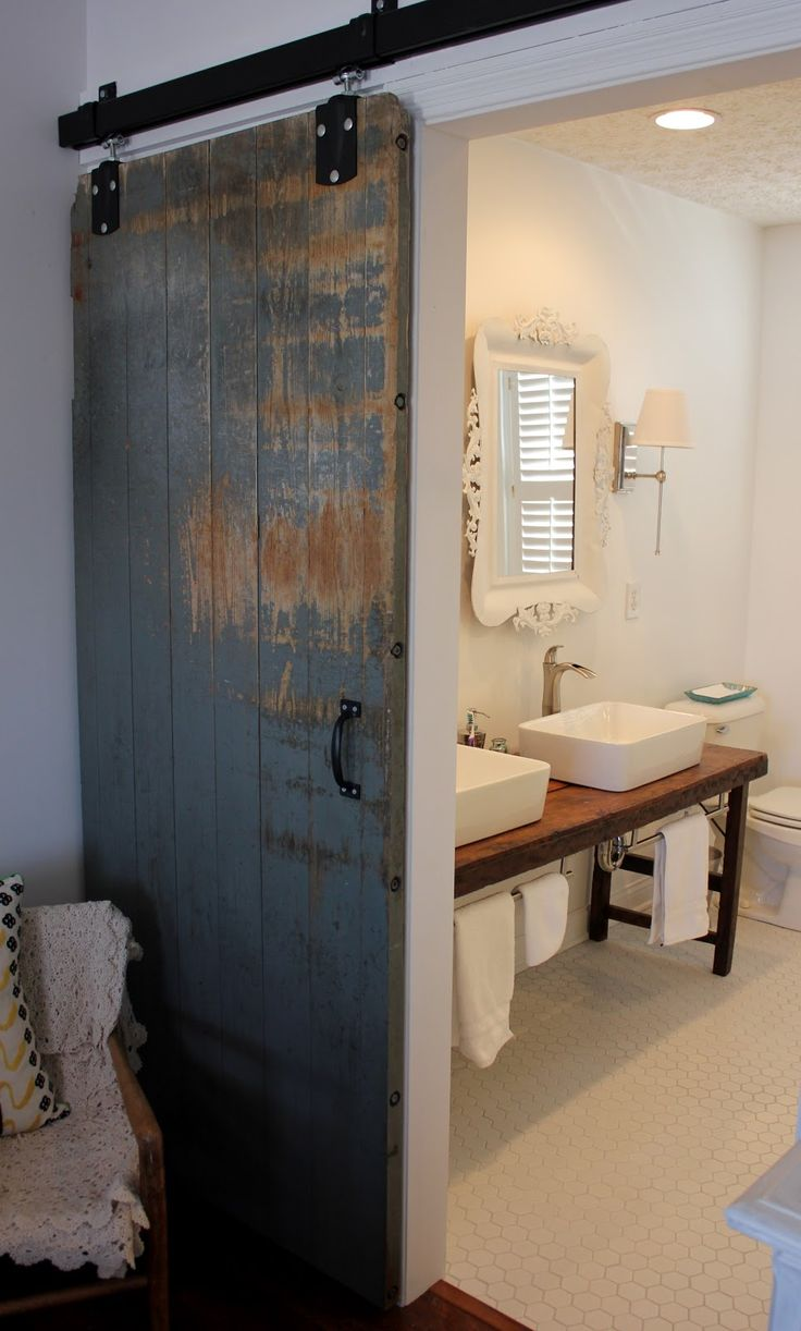 barn door for bathroom door, vanity w/ towel bar under it, vessel sink