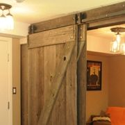The By-passing barn door hardware.  $375-400 for hardware, uses a single track so it's not as bulky
