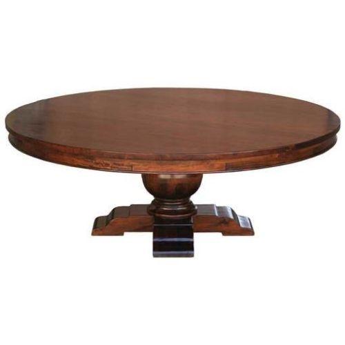 84 round solid mango wood plantation style dining table for Solid wood round dining table