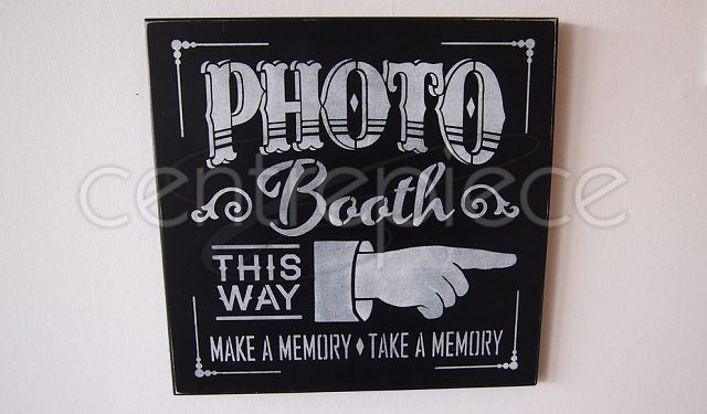 Sign Hanging Photobooth This Way