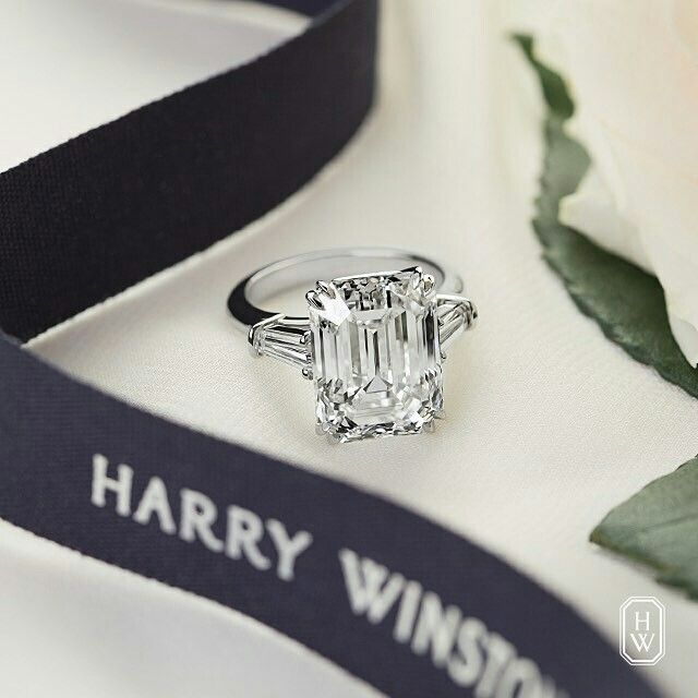 Harry Winston emerald cut three stone diamond engagement ring