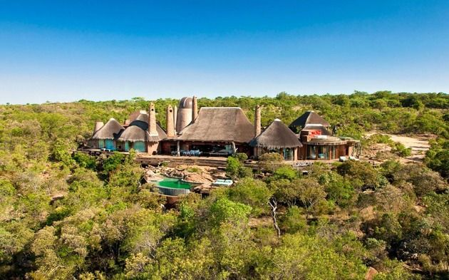 south-african-villa-with-cave-like-interiors-and-observatory-3.jpg