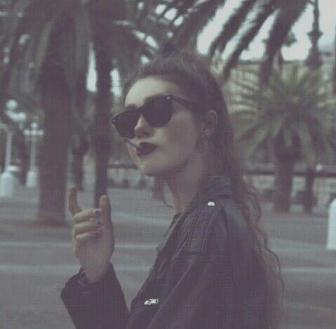 Black Sunnies And A Black Leather Jacket