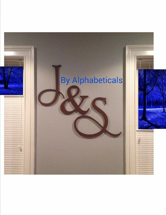 Monogram made on Etsy for our Mantle decor at wedding.   Decorative Wall Letters Initial Monogram Wall by Alphabeticals