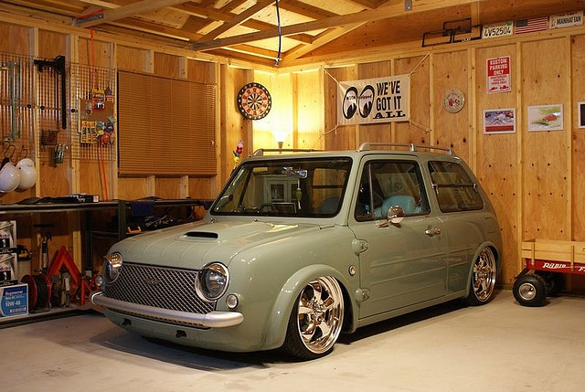 Nissan Pao. Wow! In its stock form, the Pao is a pretty pedestrian looking vehicle. Lower it and put cool wheels on it and Pao becomes Pow.