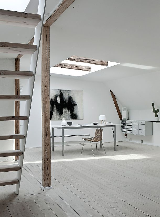 wooden stairs wooden flooring beams white walls light palette desk and chair skylight  basement office