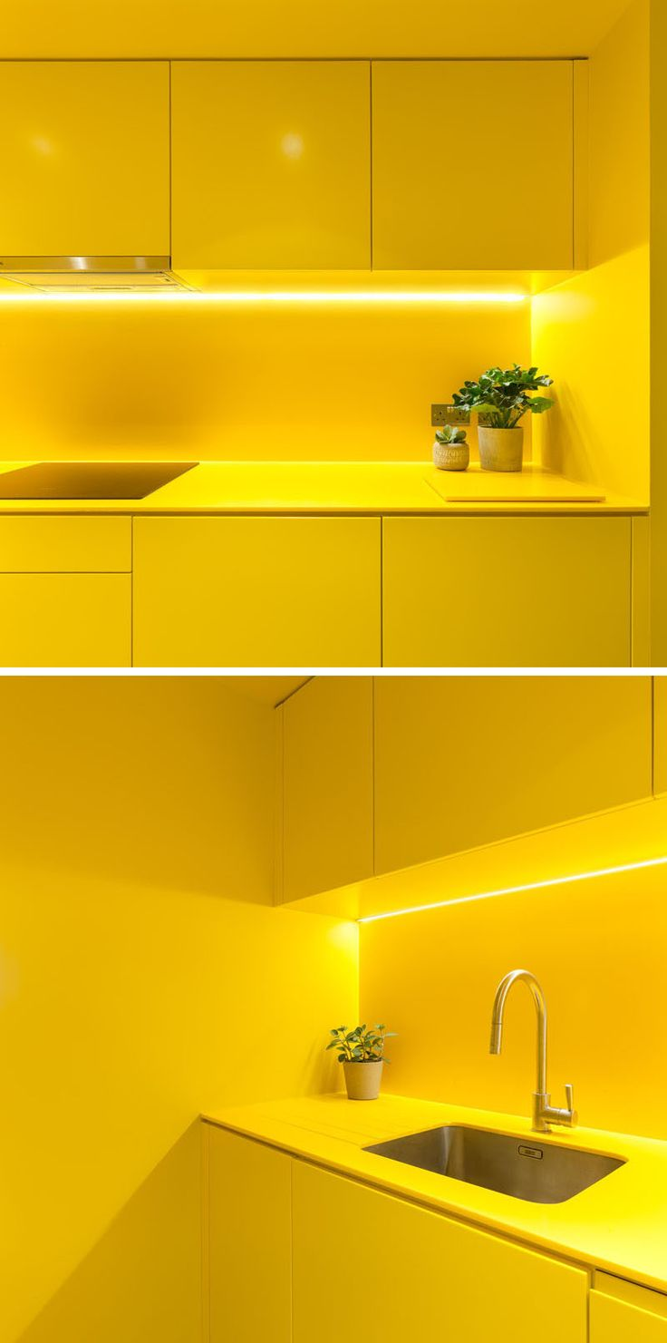 This modern kitchen has bright yellow minimalist, hardware free cabinets that complement the yellow ceiling, countertops and backsplash. #YellowKitchen #ModernKitchen #KitchenDesign
