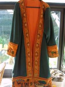 A Jacket embroidered with a Bayuex Tapestry style trim. Found at: http://images.search.yahoo.com/search/images?p=Skjoldehamn=ie8