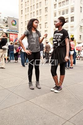 girls talking - Two girls talking together in a city square.   MUA - Wright Artistry: Artistry Wwwwrightartistrycom