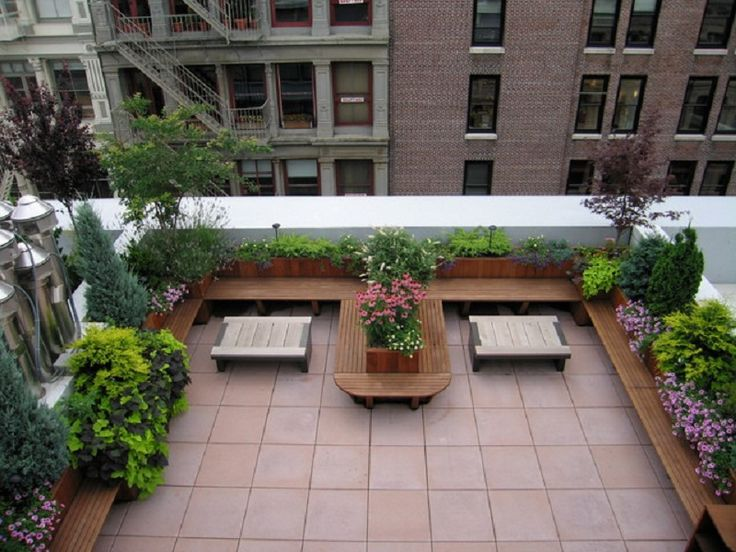 Thinke smaller in scale DS Small apartment patio ideas with wooden bench chairs and plants