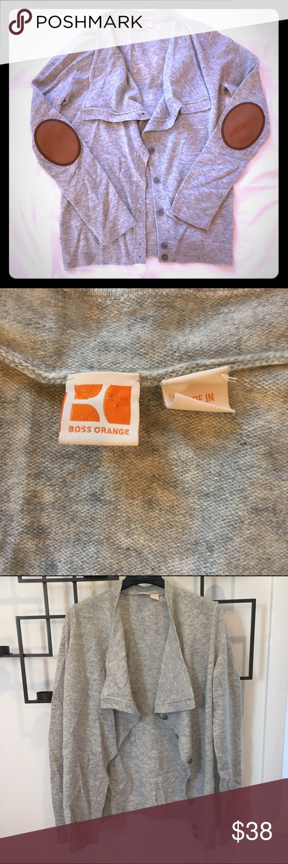 Hugo Boss women's Orange Label sweater/cardigan This is a Hugo Boss women's orange label piece, which is one of my favs. It's a lightweight grey sweater cardigan with gorgeous brown elbow patches. It's been worn once or twice, so it's in perfect condition. Please excuse the wrinkles, it's been sitting in a box for a while. This sweater is perfect for this time of year and super relevant to the menswear trends of the season . It's a size S. BOSS ORANGE Sweaters Cardigans