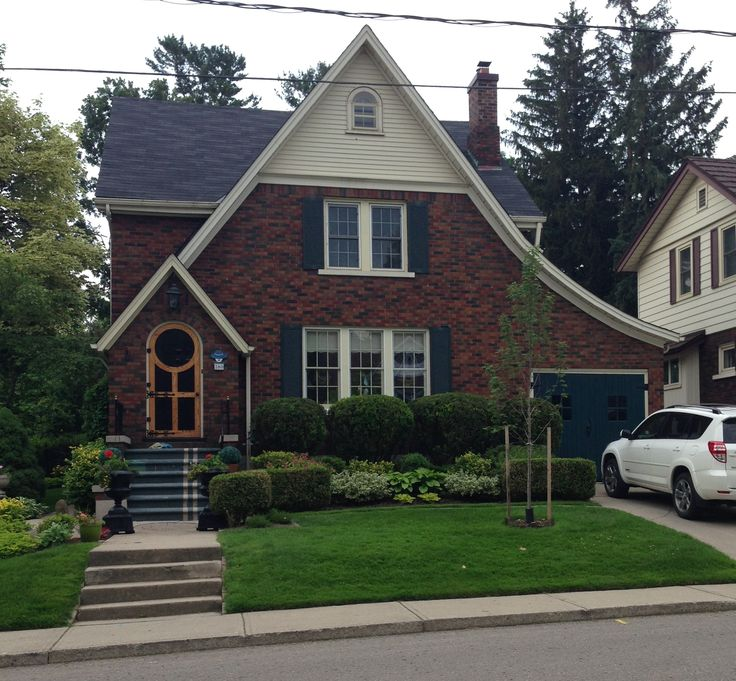 The swooping, curved lines and round-topped front door make this one of the cutest homes on my daily walking route.