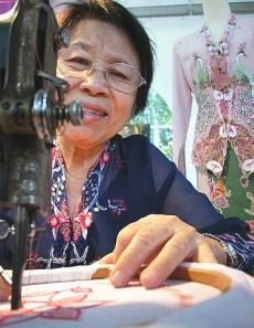 Spanning three generations, Lim Swee Kim's embroidered kebaya business is known far and wide for its fine workmanship and whimsical charm.....