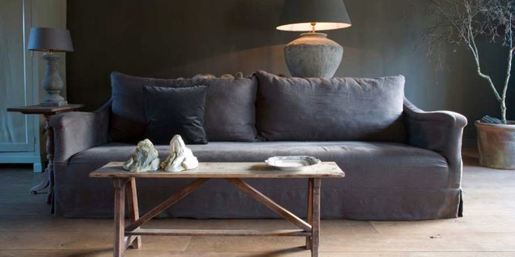 Love the gray mixed with rustic furnishings, everything so quiet like a cave from The Paper Mulberry blog.