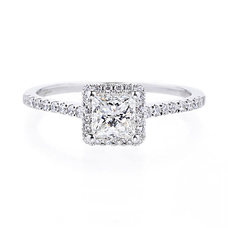 Classically gorgeous, this engagement ring features a brilliant princess-cut center diamond surrounded by a halo and band of pave diamonds.