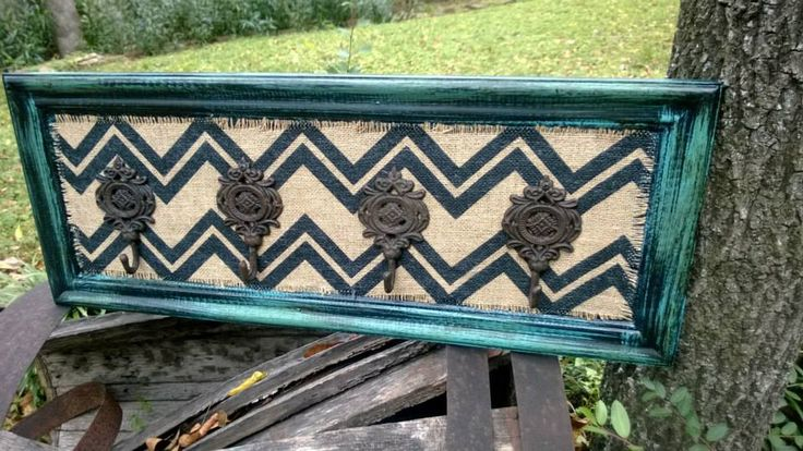 Repurposed cabinet door, chevron burlap, 4 hooks, turquoise and black distressed.