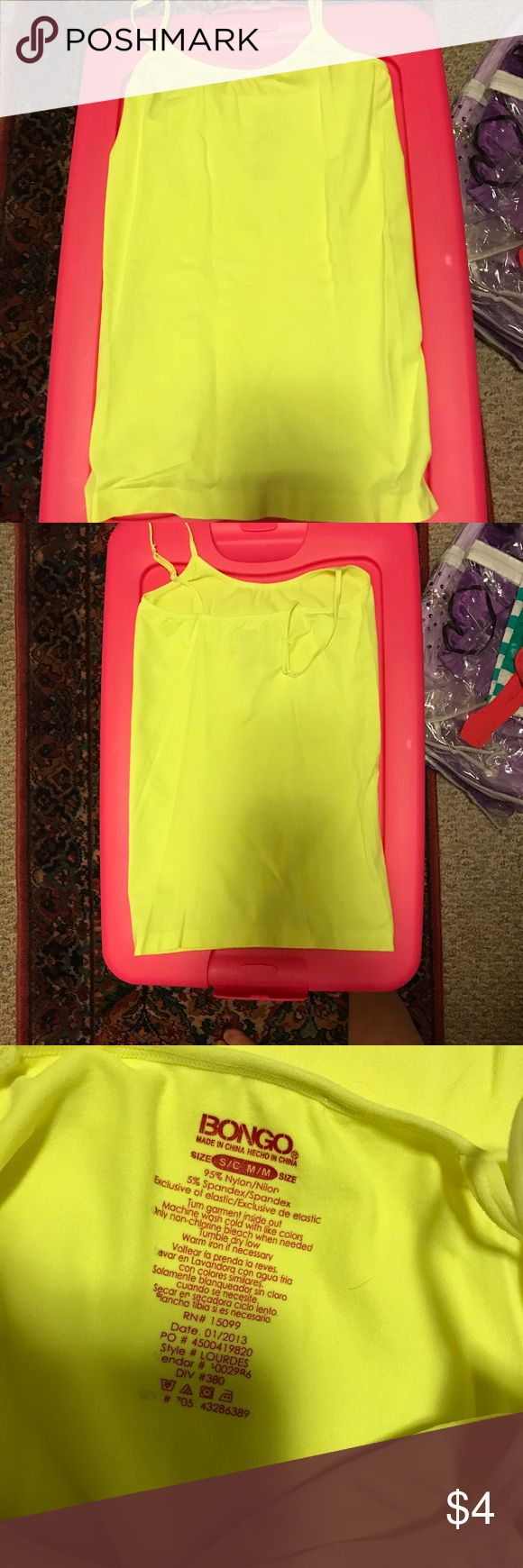 Neon yellow camisole Very bright neon camisole. Never worn. Tops Camisoles