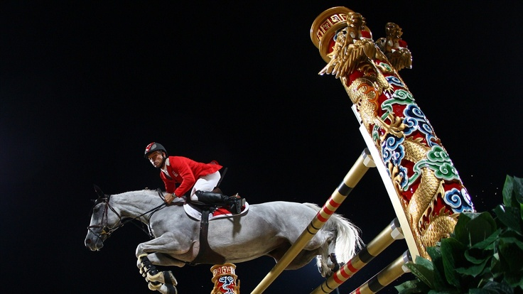 Pius Schwizer of Switzerland and Nobless M in action during the Team Jumping Competition held at the Hong Kong Olympic Equestrian Venue in Sha Tin during day 10 of the Beijing 2008 Olympic Games on 18 August 2008 in Hong Kong, China