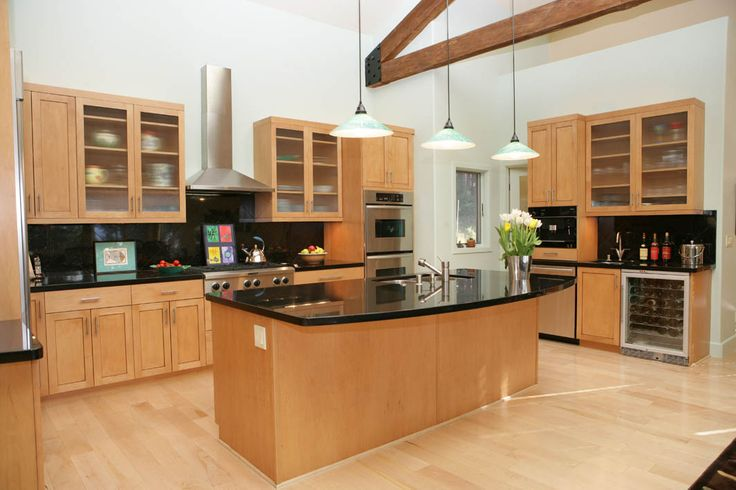 Modern Kitchen With Dark Granite And Light Maple Cabinets
