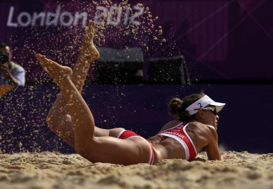 Sand is kicked up as Switzerland's Nadine Zumkehr tries to save a point during their women's preliminary round beach volleyball match against China at the London 2012 Olympic Games at Horse Guards Parade July 30, 2012. REUTERS/Marcelo del Pozo